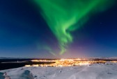 Vadsø Town under the Northern Lights ( photo Bjarne Riesto)